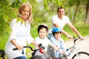 Happy family cycling in the nature.